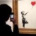 Novi Banksyev video pokazuje što je otišlo po krivu s rezanjem slike na aukciji